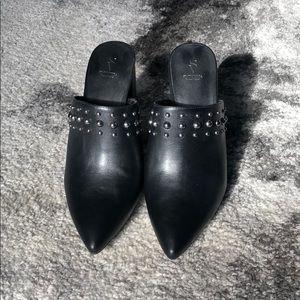 Black pointed high heel mules